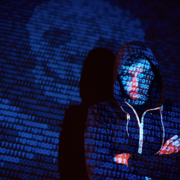 cyber hacker with hooded shirt