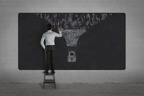 cybersecurity code written on blackboard