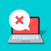 speech bubble with cross on laptop